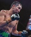 Казахстанец победил нокаутом в России и защитил титулы от WBC, WBA и WBO